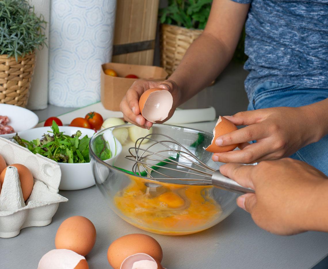 preparing a meal of eggs